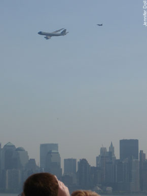The Boeing presidential 747, trailed by an F-16 fighter jet, soars low over Ground Zero yesterday. Thousands fled office buildings and homes at the terrifying 9/11-like strike.
