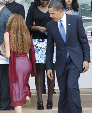 Here we find Obama searching for the truth in a young ladies back-side.
